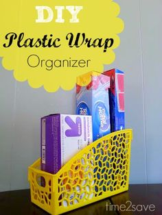 SO cute - super easy DIY Plastic Wrap Organizer (From a $1 Plastic File Bin!)  Get several to totally organize your under-sink area and brighten it up in there!
