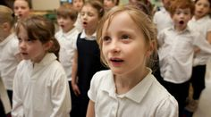 """Students sing """"O Canada"""" at St. Vincent de Paul Elementary School in Toronto."""