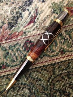 Items similar to Handmade Celtic Knot Pen - Aluminum Celtic Knot in Honduran Rosewood - Fisher Space Pen on Etsy