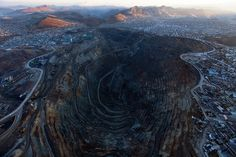 High in the Andes, A Mine Eats a 400-Year-Old City