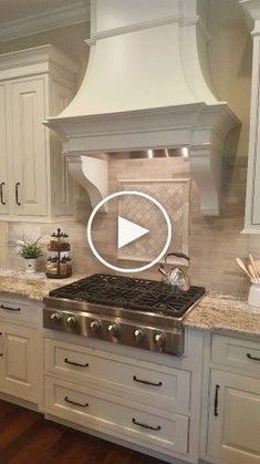 Woodgrain porcelain subway tile backsplash, traditional hood with corbels and gas cooktop with drawers beneath in kitchen remodel by KBF Design Gallery Subway Tile Backsplash, Wood Grain, Decoration, Kitchen Remodel, Drawers, Kitchen Cabinets, Traditional, Design, Gallery