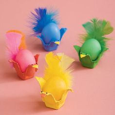 Fancy Featherd Friends Easter Craft ~ colorful chicks ~ cut egg crates into points, paint & put egg in. Tape or glue feathers to one side & put eyes on the opposite side. Great Easter Decor!