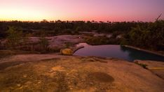 A linear dolly shot from a luxurious lodge with a private swimming pool in the foreground at nightfall with a game drive vehicle and stars in the background framed by granite rocks. Kruger National Park, Hd Video, Stock Footage, Granite, Swimming Pools, Vehicle, Rocks, Shots, Game