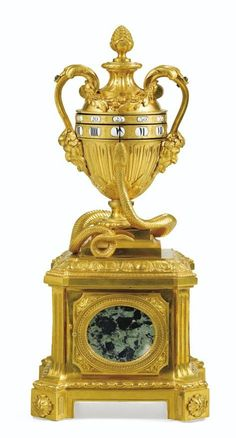 A LOUIS XVI GILT-BRONZE AND VERDE ANTICO MARBLE CLOCK, CIRCA 1775
