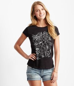 """Chart a course for the sunny coast and stay stylish along the way in our Road Trip Doodle Tee! The playful top features a fun collection of sketches inspired by New York, Miami, Hollywood and everywhere in between.<br><br>Relaxed fit. Approx. length: 24.5""""<br>Style: 8917. Imported.<br><br>60% cotton, 40% polyester.<br>Machine wash/dry.<br><br>Model height: 5'10.5"""" 