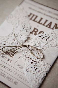 Invitations. I'm not sure what you meant by applying lace on the invitations but i like this. the paper lace can hold the invitation closed. I think that it would make people feel special when opening it =)