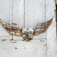Santos angel wings with heart center distressed painted putty gray/ white shabby farmhouse rusty metal wall home decor anita spero design