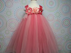 Handmade, ready to ship, one of a kind empire waist tutu dress and headband set to fit baby to about 3T toddler girl.  Elegant and sweet peach and coral tulle with handmade singed flowers, jewel accents, lace and a matching headband.  So lovely for that little flower girl or first birthday celebration.  Available at floralfolly@etsy.com. $44.00 for dress and headband set.