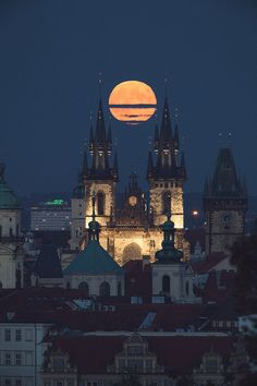Full Hunter's Moon over Tyn Church in Prague