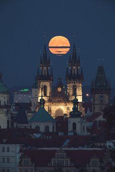 Full Hunter's Moon over Tyn Church in Prague
