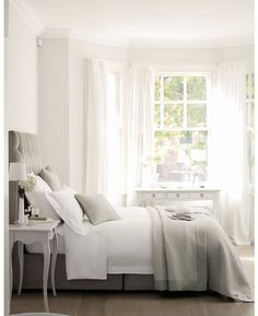 grey headboard with white sheets, grey duvet/blanket...