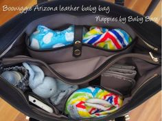 The interior of the Boowiggie Arizona #saffiano #leather #nappybag #babybag #diaperbag, packed with modern #cloth #nappies by Baby Bare