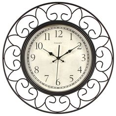 "The Chaney 18"" Decorative Wrought Iron Wall Clock features the strength of wrought iron in a delicate open metalwork design. Black arabic numbers at each hour on an antiqued white dial. This large wall clock adds a touch of traditional elegance to any room.  $59.99 at AcuRite.com Model 75365KL"