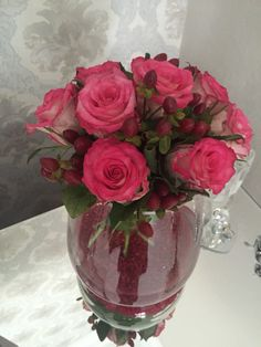 Pink roses and berries with red decorative soil