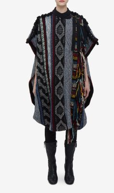 Shop now. Chloé Wool-blend woven cape. Clare Waight Keller's Chloé FW16 collection was inspired by French journalist and motorcycle adventurer Anne-France Dautheville who wore ponchos when riding her motorcycle in the 1970s. The result is this autumnally-hued take on the wardrobe classic, expertly crafted from textured panels of woven wool.