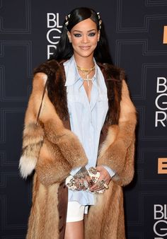 Rihanna was all smiles as she posed for pictures