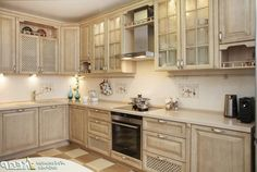 Adorable Classic Kitchen Design Ideas With Natural Wooden Cbainet Storage Also Marble The Top Backslash And Lighting Under The Cabinet Along With White Brown Chess Pattern Floor Kitchen Classic Design for Personal Kitchen Feature Kitchen design