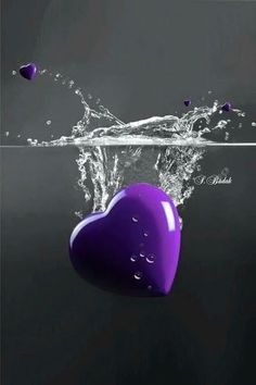Glossy purple heart dropped in water. Let's see if our love will grow.