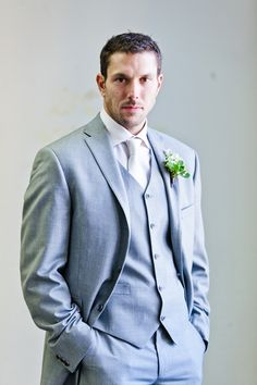 Groom, grey tux with either plum or green accents