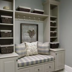very neat idea for a mudroom...store shoes, coats, umbrellas, etc. right by the door.