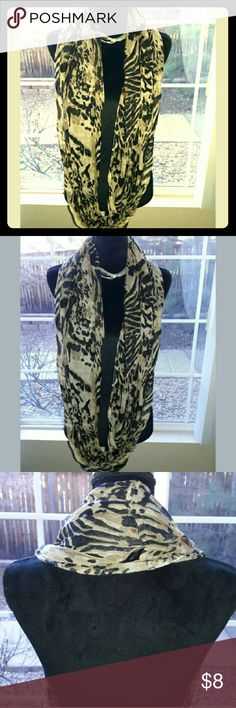 """CEJON ACCESSORIES Tiger Stripe Infinity Scarf Brown and black, tiger stripe print, 100% rayon, made in India.  Great used condition! Mild aesthetic wear overall, slight snag. See photos.  End to end - 33"""" Cejon Accessories Accessories Scarves & Wraps"""