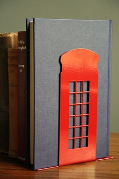 London landmark bookend red telephone box (which I would repaint blue to make it a Tardis for my Dr. Who stuff, thankyouverymuch)