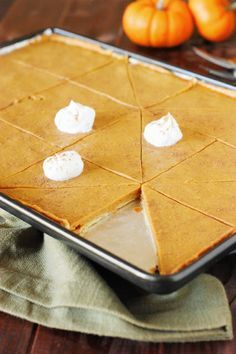 Pumpkin Slab Pie ~ Easily feed a crowd this Thanksgiving & Christmas season. All the deliciousness of traditionally-made pie, with more servings per pan! http://www.thekitchenismyplayground.com