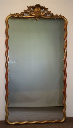 Antique French Gilt Mirror with Wave Frame, ca. 1900