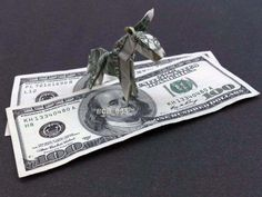 Origami Donkey with $100 Bill Background