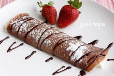 Chocolate Crepes with Strawberries - Satisfy your chocolate craving with these delicious crepes filled with strawberries and cream. So easy to make and they make a gorgeous breakfast or dessert. #mothersday #mom