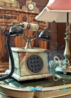 """Vintage Telephone On The Table"" by Witthaya Phonsawat at FreeDigitalPhotos.net"