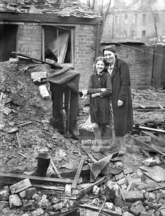 During night raids on the London area a house was hit by bombs dropped by German raiders, The occupants of the house, Mrs E Clayton and her daughter, Doris, were safe in their Anderson Shelter. They have been previously bombed out and were again saved by their shelter. When they were forced to leave the house they took their shelter with them.