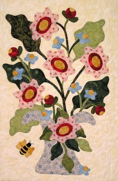 Bright and cheerful, flower appliqué in modern fabrics and more primitive patterns.  By Pearl P. Pereira Designs