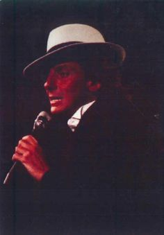Barry Manilow wearing a hat.