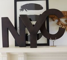 http://www.potterybarn.com/products/metal-letters-bronze/?pkey=call-art