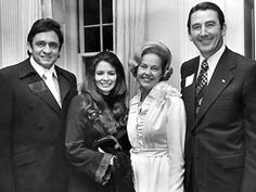 Johnny Cash & June Carter Cash join Betty and Gov. Winfield Dunn at a cocktail buffet at the Governor's Mansion following activites of the Music City Pro-Celebrity