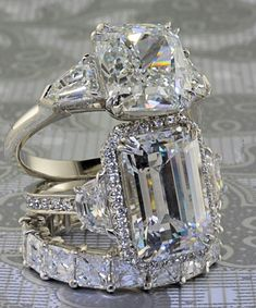 Beautiful #emerald cut #diamond #ring, Cushion cut with side diamonds and diamond eternity band.
