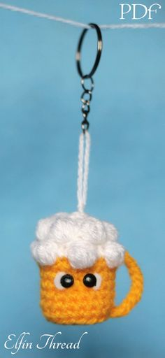 Baby beer, a cute and sweet miniature draft beer amigurumi, ready for a keychain. Its ideal as a gift for a toast to an everlasting friendship! The finished doll size is about 1.5 (4cm) To make this beer mug you need few things: scraps of yarns, crochet hook, plastic eyes, white felt, a