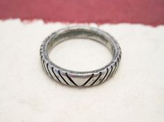 Inversus  forged iron ring with oxidized cuts  by daganigioielli, $29.50