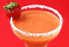 strawberry mango margaritas | 2 cups frozen strawberries, hulled  1 mango, peeled, cored and diced  2 1/2 cups crushed ice  1/2 cup tequila  2 Tbsp. fresh lime juice  1/4 cup sugar  3 Tbsp. Cointreau (orange-flavored liqueur)  optional garnishes: fresh strawberries, diced mangoes, lime wedges, and/or salt for the rims of glasses