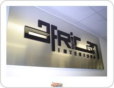 the worlds best sign companies gallery of signs banners printing and advertising signs > Staff Favorites Melbourne Corporate laser cut stainless steel and acrylic reception signage Laser Cut Signage, Mesh Banner, Mesh Fencing, Laser Machine, Sign Design, Acorn, Laser Cutting, Reception, Stainless Steel