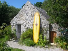 Something about this just makes me happy. Who wouldn't want to live in a stone cottage and surf on an awesome yellow board?