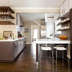 Perfect Peninsula - I don't love the finishes here but the layout with open space above the penninsula and open shelving to the right is interesting. It makes a galley kitchen feel much more open