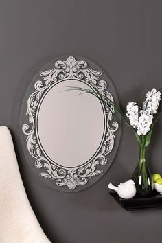 Add some style to the entry way of your home by displaying this chic mirror.  - Oval mirror   - Transparent ornate motif bordering   - Ready to hang
