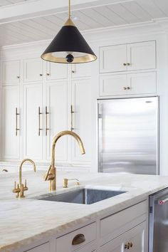 A stainless steel kitchen sink with an antique brass faucet is fitted to a white island fitte. A stainless steel kitchen sink with an antique brass faucet is fitted to a white island fitted with . Gold Kitchen Faucet, Kitchen Cabinetry, Kitchen Sink, Kitchen Backsplash, Diy Kitchen, Undermount Stainless Steel Sink, Stainless Steel Kitchen, Antique Brass Faucet, Brass Hardware