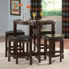 Hmmm. @Overstock - Let this pub set be the centerpiece of your dining area. Featuring sharp lines and tight wedge seating, this compact five-piece counter-height dining set is the perfect seating solution for small living spaces where style and function is needed.http://www.overstock.com/Home-Garden/ETHAN-HOME-Oliver-5-piece-Counter-Height-Pub-Set/5862369/product.html?CID=214117 $404.99