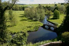 Haddon Hall, Derbyshire Here's great example of the singular beauty of the English Countryside. The deep green fields, pleasant lowland river augmented by an old bridge.This is Haddon hall in northern England, but could be one of a thousand places across the country.