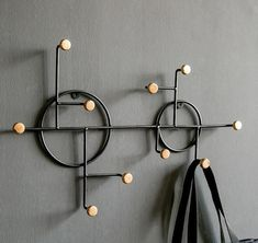 Perfect for small spaces this cast iron metal wall rack will hold all your Coats, or it can be used creatively as a way to display hanging planters and other hanging decor items ... #metalwallrack #wallrack #walldecor #Coathanger #coatrack #coathanger #wallhook Wall Hangers For Clothes, Wooden Coat Hangers, Wooden Wall Hooks, Metal Wall Decor, Wall Mounted Coat Rack, Wall Racks, Modern Coat Hooks, Industrial Coat Rack, Entryway