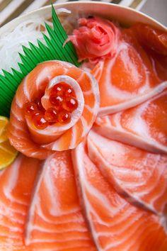 鮭の刺身 Salmon Sashimi  Really beautiful fish, so odd that the plastic is used instead of shiso or even a seaweed salad.
