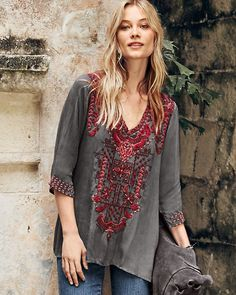 Four shades of red add depth and detail to the intricately embroidered paisley and geometric shapes of this tunic. Created by Johnny Was, the company renowned for exceptional embroidery and carefree style.